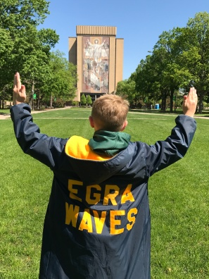Connor acknowledging a large mural (touchdown Jesus) on Notre Dame's campus.