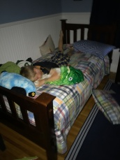 Last day of school. Connor has to make his bed in the morning, so he has decided that it is easier to just sleep on top of comforter.