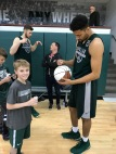 Kenny Goins signing Connor's Basketball.