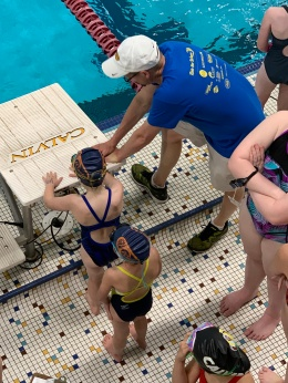 Brandon coaches Mia with last minute advice (probably how to dive in).